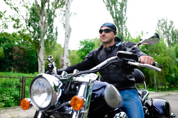 A man in a sunglasses on a motorcycle.