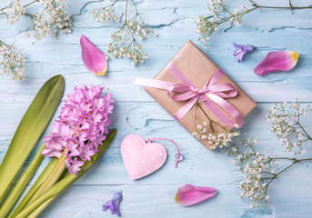 Pastel colored flower and a gift box