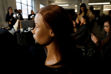 A mannequin sits backstage as models have their her hair and makeup done before the  3.1 Phillip Lim's 2018 collection during New York Fashion Week, in New York