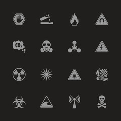 Danger icons - Gray symbol on black background. Simple illustration. Flat Vector Icon.