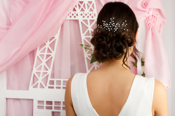 Image from back of woman with ornament in hairstyle