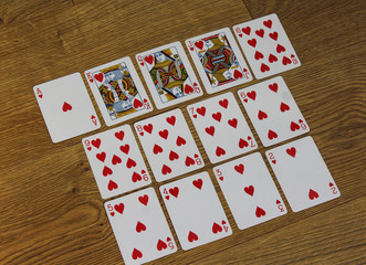 Poker cards clubs set two color classic design on wooden background