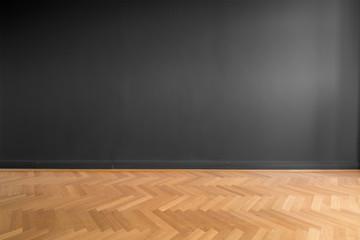 Obraz   black wall background and parquet floor - fototapety do salonu