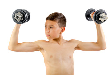 Teenage boy exercising with dumbbells