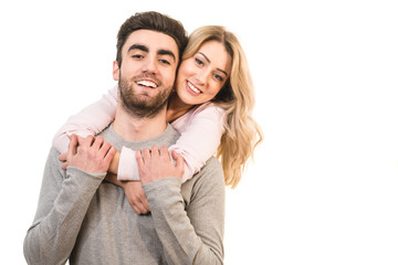 The happy man and a woman hug on the white background