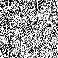 Seamless geometric pattern. Ornament in patchwork style. Grunge texture. Ethnic and tribal motifs. Black and white print.