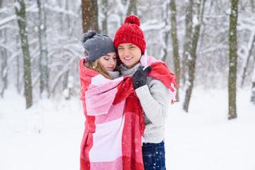 Hugs of beautiful couple in plaid