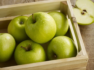 Green apples in crate
