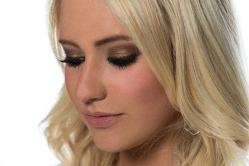 Close Up Head Shot of a Beautiful Blonde Woman Looking Down