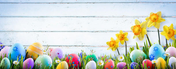 Easter - Daffodils And Eggs With Old Wooden Background