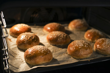 Tasty buns with sesame. Freshly Baked Buns. Hot, fresh from the oven hamburger buns. Homemade...