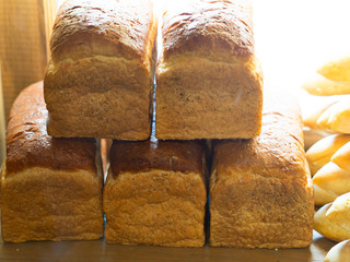 Breads or loafs in a bakery and coffee shop, fresh and homemade style breads or loafs for breakfast, snack and bakery, carbohydrate and energy food