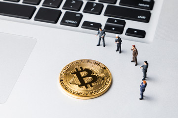 Group of people watching bitcoins. Virtual currency concept.