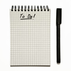 To do list on gridded spiral notepad - isolated on white