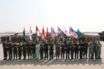 Officials pose for a photo during opening ceremony of Cobra Gold, Asia's largest annual multilateral military exercise, outside Bangkok