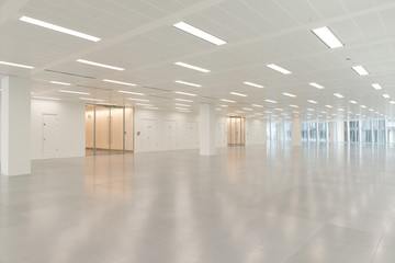 Huge Empty Office Building Interior with Electric Lighting