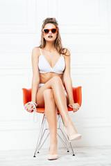 alluring girl in armchair