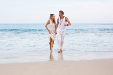 Couple on vacation walking on the beach