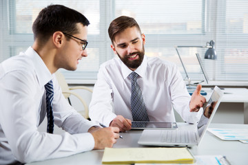 Young businessmen at office