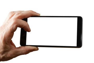 Human hand holding smartphone with empty screen to take a photo. Empty white blank mockup isolated on white.