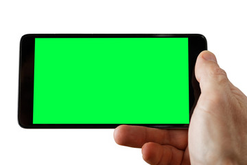 Human hand holding smartphone with empty screen to take a photo. Empty green blank mockup isolated on white.