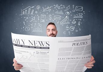 Businessman reading newspaper
