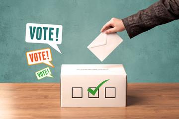 placing a voting slip into a ballot box