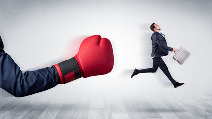 Red boxing glove knocks out little businessman