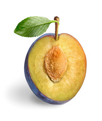 Half of ripe sweet plum on white background