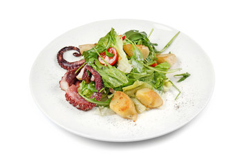 Plate of tasty warm salad with octopus on white background