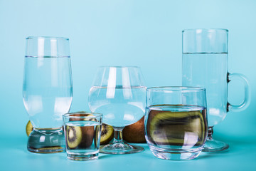 Transparent water in different glasses