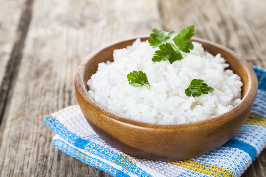 Boiled rice in a wooden bowl