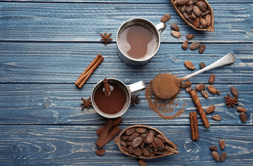 Composition with cocoa pod and beans on wooden table