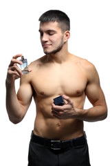 Handsome man with bottle of perfume on white background