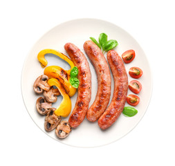 Plate with delicious grilled sausages and vegetables on white background