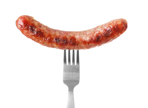 Fork with delicious grilled sausage on white background