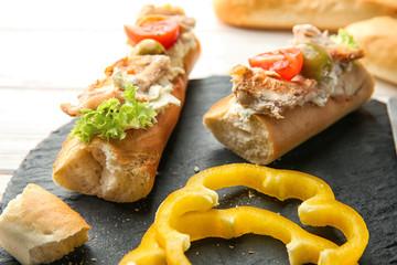Slate plate with tasty chicken bruschettas, closeup