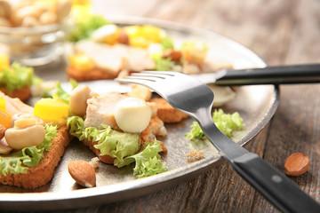 Plate with tasty chicken bruschettas, closeup