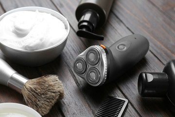Shaving accessories for man on wooden background