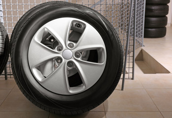 Car tire with rim indoors