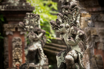 Traditional ancient sculptures of temple in Bali, Indonesia