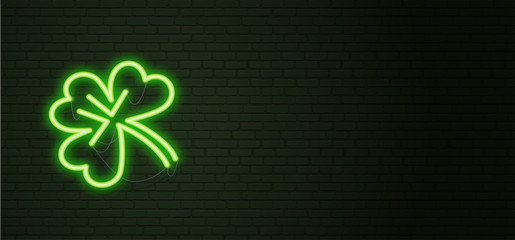 St Patricks Day Neon sign and green brick wall. Realistic sign. National holiday symbol in Ireland. Irish Shamrock. Template night horizontal banner.