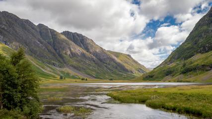 Valley view below the mountains of Glencoe, Lochaber, HIghlands, Scotland, UK