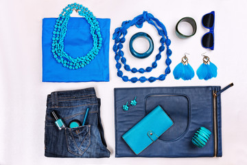 Trendy woman accessories. Blue casual outfit. Accessories and clothes. Top view.