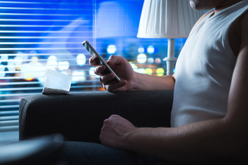 Drug dealer using mobile phone. Selling and buying cocaine online concept. Criminal texting with smartphone late at night. Illegal internet business.