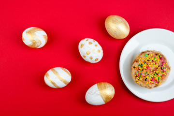 Happy Easter. Painted eggs on red background. Easter Cake - Russian and Ukrainian Traditional Kulich, Paska Easter Bread. Top view. Copy space for text.