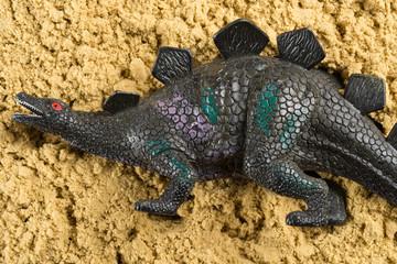 Stegosaurus on sand concept of historical animal excavating