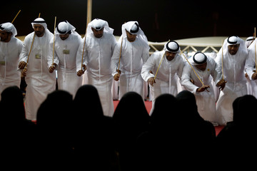Saudi men perform a traditional dance during Janadriyah Cultural Festival on the outskirts of Riyadh