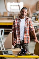 Portrait of confident carpenter