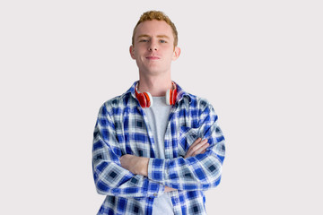 Content Red Haired Student with Headphones on Neck